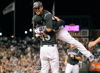DENVER, CO - JULY 20:  Carlos Gonzalez #5 of the Colorado Rockies celebrates his walk-off RBI single in the bottom of the ninth with Jhoulys Chacin #45 as the Rockies defeated the Braves 3-2 at Coors Field on July 20, 2011 in Denver, Colorado.  (Photo by