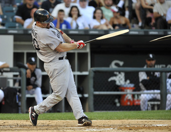 CHICAGO, IL - JULY 30: Kevin Youkilis #20 of the Boston Red Sox breaks his bat as he hits an RBI single in the fifth inning against the Chicago White Sox  on July 30, 2011 at U.S. Cellular Field in Chicago, Illinois.  (Photo by David Banks/Getty Images)