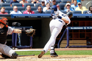 NEW YORK, NY - JULY 31:  Derek Jeter #2 of the New York Yankees reacts after being hit by a pitch in the third inning by pitcher Jake Arrieta #34 of the Baltimore Orioles on July 31, 2011 at Yankee Stadium in the Bronx borough of New York City.  (Photo by