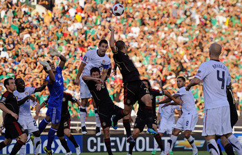 PASADENA, CA - JUNE 25:  Carlos Bocanegra #3 of United States elevates for a header as Israel Castro # 8 and goalkeepr Alfredo Talavera #12 of Mexico defend during the 2011 CONCACAF Gold Cup Championship at the Rose Bowl on June 25, 2011 in Pasadena, Cali