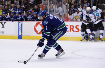 VANCOUVER, CANADA - MAY 24:  Dan Hamhuis #2 of the Vancouver Canucks plays the puck on his backhand in Game Five of the Western Conference Finals against the San Jose Sharks during the 2011 Stanley Cup Playoffs at Rogers Arena on May 24, 2011 in Vancouver