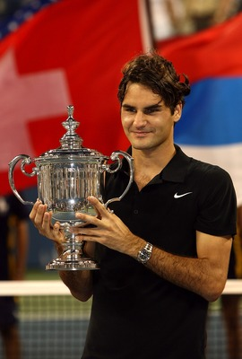 NEW YORK - SEPTEMBER 09:  Roger Federer of Switzerland celebrates with the trophy after defeating Novak Djokovic of Serbia by a score of 7-6(4), 7-6(2), 6-4 to win the Men's Singles Final on day fourteen of the 2007 U.S. Open in Arthur Ashe Stadium at the