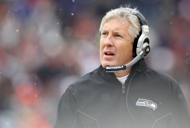 CHICAGO, IL - JANUARY 16:  Head coach Pete Carroll of the Seattle Seahawks looks on from the sideline in the first quarter against the Chicago Bears in the 2011 NFC divisional playoff game at Soldier Field on January 16, 2011 in Chicago, Illinois.  (Photo