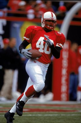 23 Sep 2000: T.J. Hollowell #40 of the Nebraska Cornhuskers carries the ball as he runs down field during the game against the Iowa Hawkeyes at the Memorial Stadium in Lincoln, Nebraska. The Cornhuskers defeated the Hawkeyes 42-13.Mandatory Credit: Brian