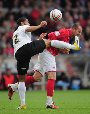 NOTTINGHAM, ENGLAND - MAY 12:  Ashley Williams of Swansea City challenges Kris Boyd of Nottingham Forest during the npower Championship Play Off Semi Final First Leg match between Nottingham Forest and Swansea City at City Ground on May 12, 2011 in Nottin