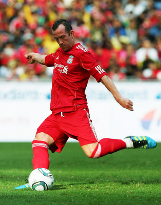KUALA LUMPUR, MALAYSIA - JULY 16: Charlie Adam of Liverpool scores from the penalty spot during the pre-season friendly match between Malaysia and Liverpool at the Bukit Jalil National Stadium on July 16, 2011 in Kuala Lumpur, Malaysia. (Photo by Stanley