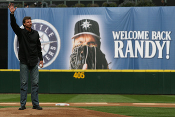 SEATTLE - APRIL 12:  Former Mariners star Randy Johnson waves to the crowd prior to throwing out the ceremonial first pitch before the Mariners' home opener against the Oakland Athletics at Safeco Field on April 12, 2010 in Seattle, Washington. (Photo by
