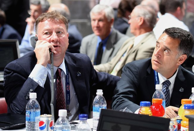 MONTREAL, QC - JUNE 27:  (L-R) General Manager Mike Gillis and assistant General Manager Laurence Gilman of the Vancouver Canucks sit at the draft table during the 2009 NHL Entry Draft at the Bell Centre on June 27, 2009 in Montreal, Quebec, Canada. (Phot