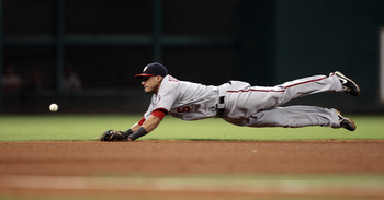 HOUSTON - JULY 19:  Shortstop Ian Desmond #6 of the Washington Nationals makes a diving attempt on a ground ball during a baseball game against the Houston Astros at Minute Maid Park on July 19, 2011 in Houston, Texas.  (Photo by Bob Levey/Getty Images)