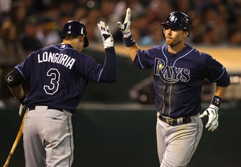 OAKLAND, CA - JULY 26:  Ben Zobrist #18 of the Tampa Bay Rays celebrates with teammate Evan Longoria #3 after hitting a home run in the eighth inning agains the Oakland Athletics at O.co Coliseum on July 26, 2011 in Oakland, California.  (Photo by Jed Jac
