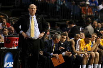 TAMPA, FL - MARCH 19:  Head coach Ben Howland of the UCLA Bruins and his players look on from the bench in the final minute of the game against the Florida Gators during the third round of the 2011 NCAA men's basketball tournament at St. Pete Times Forum