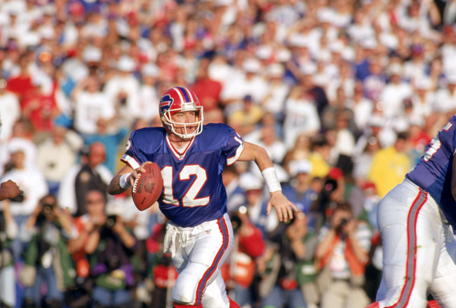 PASADENA, CA - JANUARY 31:  Quarterback Jim Kelly #12  of the Buffalo Bills looks to pass against the Dallas Cowboys defense during Super Bowl XXVII at the Rose Bowl on January 31, 1993 in Pasadena, California.  The Cowboys won 52-17.  (Photo by George Ro