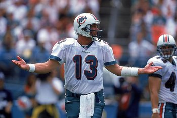 19 Sep 1999: Dan Marino #13 of the Miami Dolphins questions a call during the game against the Arizona Cardinals at the Pro Player Stadium in Miami, Florida. The Dolphins defeated the Cardinals 19-16. Mandatory Credit: Andy Lyons  /Allsport