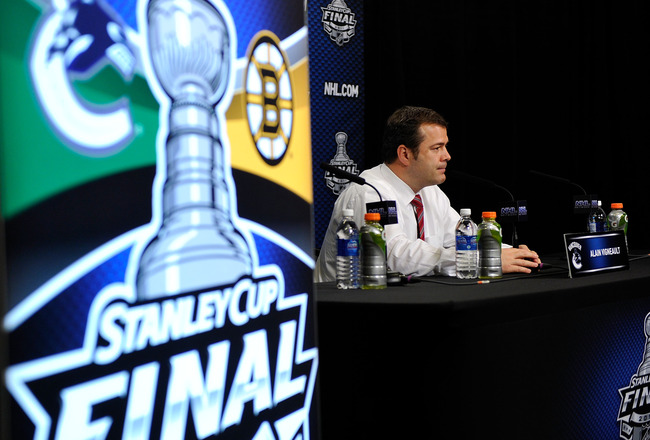 VANCOUVER, BC - JUNE 10:  Head coach Alain Vigneault of the Vancouver Canucks talks to the media after Game Five of the 2011 NHL Stanley Cup Final at Rogers Arena on June 10, 2011 in Vancouver, British Columbia, Canada.  (Photo by Rich Lam/Getty Images)
