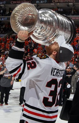 PHILADELPHIA - JUNE 09:  Kris Versteeg #32 of the Chicago Blackhawks kisses the Stanley Cup after teammate Patrick Kane scored the game-winning goal in overtime to defeat the Philadelphia Flyers 4-3 and win the Stanley Cup in Game Six of the 2010 NHL Stan