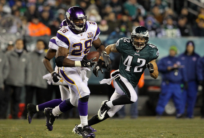 PHILADELPHIA, PA - DECEMBER 28: Adrian Peterson #28 of the Minnesota Vikings runs against Kurt Coleman #42 of the Philadelphia Eagles at Lincoln Financial Field on December 28, 2010 in Philadelphia, Pennsylvania. (Photo by Jim McIsaac/Getty Images)