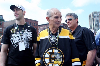 BOSTON, MA  - JUNE 18: (L-R) Zdeno Chara, Jeremy Jacobs, and Cam Neely, of the Boston Bruins react to cheers during the Stanley Cup victory parade on June 18, 2011 in Boston, Massachusetts.  (Photo by Jim Rogash/Getty Images)