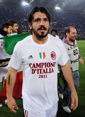 ROME, ITALY - MAY 07: Gennaro Gattuso of Milan celebrates the victory after the Serie A match between AS Roma and AC Milan at Stadio Olimpico on May 7, 2011 in Rome, Italy.  (Photo by Giuseppe Bellini/Getty Images)