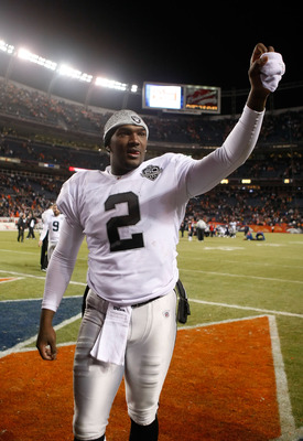 DENVER - DECEMBER 20:  Quarterback JaMarcus Russell #2 celebrates following the Oakland Raiders' victory over the Denver Broncos at Invesco Field at Mile High on December 20, 2009 in Denver, Colorado. The Raiders defeated the Broncos 20-19.  (Photo by Jef