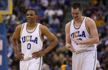 WESTWOOD, CA - FEBRUARY 02:   (L-R)Russell Westbrook #0 and Kevin Love #42 of the UCLA Bruins celebrate during game against the Arizona Wildcats at Pauley Pavilion on February 2, 2008 in Westwood, California.  (Photo by Lisa Blumenfeld/Getty Images)