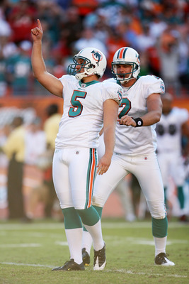 MIAMI GARDENS, FL - NOVEMBER 15:  Place kicker Dan Carpernter #5 and holder Brandon Fields #2 of the Miami Dolphins celebrate Carpenter's game-winning 25-yard field goal to beat the Tampa Bay Buccaneers at Land Shark Stadium on November 15, 2009 in Miami
