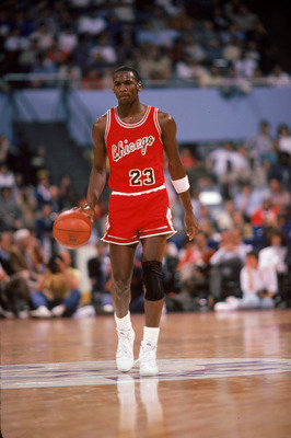 LOS ANGELES, CA:  Michael Jordan #23 of the Chicago Bulls brings the ball upcourt against the Los Angeles Clippers during a 1984-85 season game at the Sports Arena in Los Angeles, California.  (Photo by Rick Stewart/Getty Images)