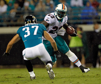 JACKSONVILLE, FL - AUGUST 21:  Ronnie Brown #23 of the Miami Dolphins attempts to run past Sean Considine #37 of the Jacksonville Jaguars during the preseason game at EverBank Field on August 21, 2010 in Jacksonville, Florida.  (Photo by Sam Greenwood/Get
