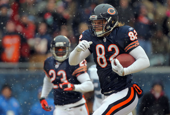 CHICAGO, IL - JANUARY 16:  Tight end Greg Olsen #82 of the Chicago Bears runs after he catches a 58-yard touchdown in the first quarter in front of Lawyer Milloy #36 of the Seattle Seahawks in the 2011 NFC divisional playoff game at Soldier Field on Janua