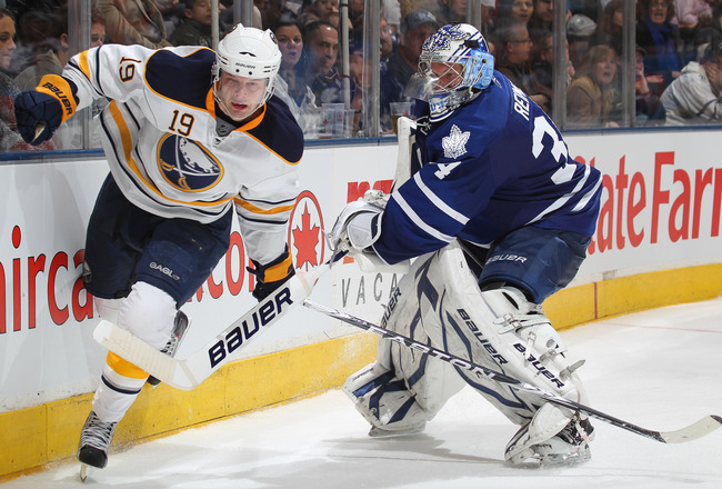 TORONTO, CANADA - MARCH 12:  Tim Connolly #19 of the Buffalo Sabres is held up by James Reimer #34 of the Toronto Maple Leafs in a game on March 12, 2011 at the Air Canada Centre in Toronto, Canada. The Leafs defeated the Sabres 4-3. (Photo by Claus Ander