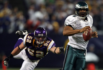 MINNEAPOLIS - JANUARY 4:  Donovan McNabb #5 of the Philadelphia Eagles scrambles as Chad Greenway #52 of the Minnesota Vikings nearly makes the tackle during the NFC Wild Card playoff game on January 4, 2009 at the Hubert H. Humphrey Metrodome in Minneapo