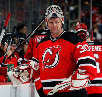 NEWARK, NJ - APRIL 02:  Goalie Martin Brodeur #30 of the New Jersey Devils takes a break during a timeout in the third period with his team losing 3-1 in an NHL hockey game against the Montreal Canadians at the Prudential Center on April 2, 2011 in Newark