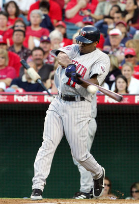 ANAHEIM, CA - JULY 4: Jacque Jones #11 of the Minnesota Twins hits a one run double against the Los Angeles Angels of Anaheim on July 4, 2005 at Angel Stadium in Anaheim, California.  (Photo by Lisa Blumenfeld/Getty Images)