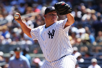 NEW YORK, NY - JULY 30:  Bartolo Colon #40 of the New York Yankees pitches against the Baltimore Orioles during game one of their double header on July 30, 2011 at Yankee Stadium in the Bronx borough of New York City.  (Photo by Nick Laham/Getty Images)