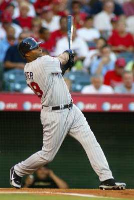 ANAHEIM, CA - MAY 30:  Torii Hunter #48 of the Minnesota Twins hits a two-run home run against the Los Angeles Angels of Anaheim during the first inning of the MLB game May 30, 2006 at Angel Stadium in Anaheim, California.  (Photo by Christian Petersen/Ge