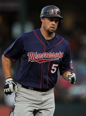 ARLINGTON, TX - JULY 27:  Michael Cuddyer #5 of the Minnesota Twins hits a solo home run against the Texas Rangers at Rangers Ballpark in Arlington on July 27, 2011 in Arlington, Texas.  (Photo by Ronald Martinez/Getty Images)