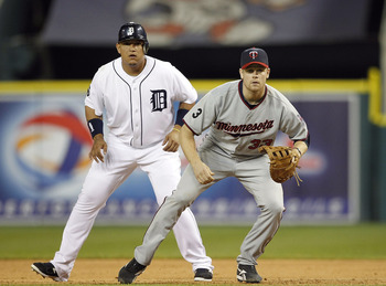DETROIT - JUNE 01: Miguel Cabrera #24 of the Detroit Tigers and Justin Morneau #33 of the Minnesota Twins look towards home plate during the game at Comerica Park on June 1, 2011 in Detroit, Michigan. The Tigers defeated the Twins 4-2. (Photo by Leon Hali