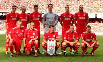 KUALA LUMPUR, MALAYSIA - JULY 16: (L-R back row) Jack Robinson, Raul Meireles, Conor Coady, Brad Jones, Daniel Agger and Andy Carroll, (L-R front row) Jay Spearing, Joe Cole, Jamie Carragher, Charlie Adam and John Flanagan of Liverpool line up for a team