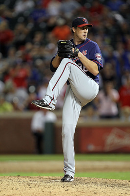 ARLINGTON, TX - JULY 26:  Joe Nathan #36 of the Minnesota Twins throws against the Texas Rangers  at Rangers Ballpark in Arlington on July 26, 2011 in Arlington, Texas.  (Photo by Ronald Martinez/Getty Images)