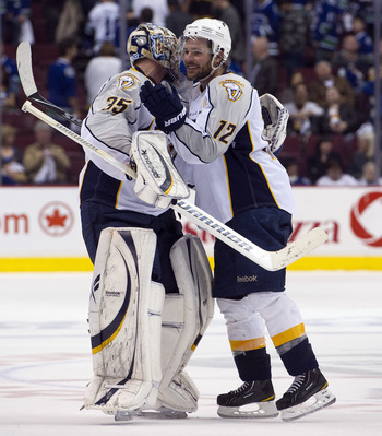 VANCOUVER, CANADA - APRIL 30: Goalie Pekka Rinne #35 of the Nashville Predators is congratulated by Mike Fisher #12 after defeating the Nashville Predators 2-1 in the second overtime period in Game Two of the Western Conference Semifinals during the 2011
