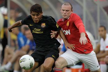 LANDOVER, MD - JULY 30:  Jonathan dos Santos #18 of Barcelona and Wayne Rooney #10 of Manchester United go after the ball during the first half of a friendly match at FedExField on July 30, 2011 in Landover, Maryland.  Manchester United won 2-1.  (Photo b