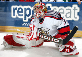 MANCHESTER, NH - FEBRUARY 13:  Goalie Joey MacDonald #31 of the Grand Rapids Griffins streches before the rapid fire event at the American Hockey League All Star Skills Competition on February 13, 2005 at Verizon Wireless Arena in Manchester, New Hampshir