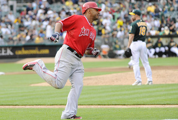 OAKLAND, CA - JULY 16: Vernon Wells #10 of the Los Angeles Angels of Anaheim runs the bases after hitting a home run off of Rich Harden #18 of the Oakland Athletics in the six inning of game two of a double header at the O.co Coliseum July 16, 2011 in Oak