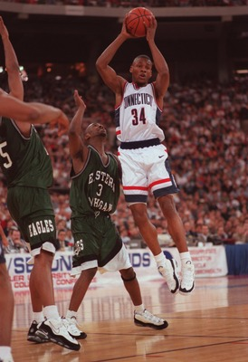 16 Mar 1996: Ray Allen #34 of UCONN goes up to make a pass over Derric Dial #3 of Eastern Michigan during the Huskies 95-81 win over Eastern Michigan at the RCA Dome in Indianapolis, Indiana.