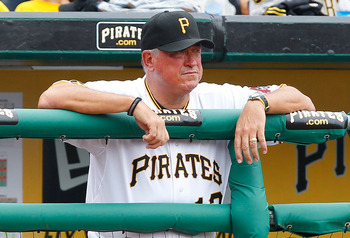 PITTSBURGH - JULY 24:  Manager Clint Hurdle #13 of the Pittsburgh Pirates watches the game from the dugout against the St Louis Cardinals during the game on July 24, 2011 at PNC Park in Pittsburgh, Pennsylvania.  (Photo by Jared Wickerham/Getty Images)