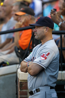 BALTIMORE, MD - JULY 16:  Manager Manny Acta #11 of the Cleveland Indians during the Indians game against the Baltimore Orioles at Oriole Park at Camden Yards on July 16, 2011 in Baltimore, Maryland.  (Photo by Rob Carr/Getty Images)