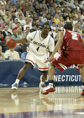 PHOENIX - MARCH 27:  Ben Gordon #4 of the University of Connecticut Huskies is covered by Emmett Thomas #2 of the Alabama Crimson Tide during the fourth round of the NCAA Division I Men's Basketball Tournament at America West Arena on March 27, 2004 in Ph