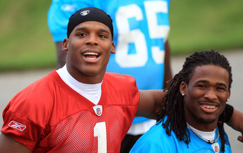 SPARTANBURG, SC - JULY 30:  Teammates Cam Newton #1 and DeAngelo Williams #34 of the Carolina Panthers during training camp at Wofford College on July 30, 2011 in Spartanburg, South Carolina.  (Photo by Streeter Lecka/Getty Images)