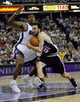 SACRAMENTO, CA - APRIL 28:  Manu Ginobili #20 of the San Antonio Spurs drives against Ron Artest #93 of the Sacramento Kings in game three of the Western Conference Quarterfinals during the 2006 NBA Playoffs on April 28, 2006 at ARCO Arena in Sacramento,