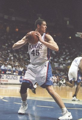 15 Mar 1997:  Forward Raef LaFrentz of the Kansas Jayhawks holds the ball during a playoff game against the Purdue Boilermakers at the Pyramid in Memphis, Tennessee.  Kansas won the game 75-61. Mandatory Credit: Andy Lyons  /Allsport