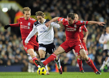 LONDON, ENGLAND - NOVEMBER 28:  Luka Modric of Tottenham Hotspur is tackled by Jamie Carragher of Liverpool during the Barclays Premier League match between Tottenham Hotspur and Liverpool at White Hart Lane on November 28, 2010 in London, England.  (Phot